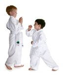 Karate Buddies. Two four year old boys sparring and practicing karate.  Clipping path included Royalty Free Stock Photography