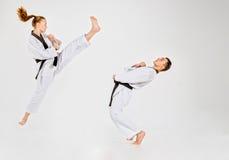 Karate chłopiec z czarnymi paskami i dziewczyna Zdjęcia Stock