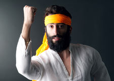 Karate expert with power gesture shot against grey background Royalty Free Stock Image