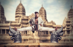 Karate fighter does the splits Royalty Free Stock Photo