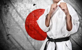 Karate fighter and japan flag Royalty Free Stock Photos