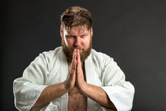 Karate fighter meditating Stock Photography