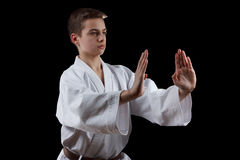 Karate Fighter in white Kimono Isolated on Black Royalty Free Stock Photography