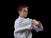 Karate Fighter in white Kimono Isolated on Black Royalty Free Stock Photo