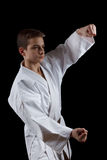 Karate Fighter in white Kimono Isolated on Black Royalty Free Stock Images