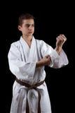 Karate Fighter in white Kimono Isolated on Black Stock Photos