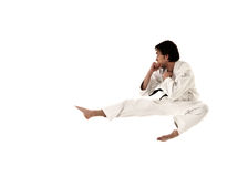 Karate flying kick young male fighter isolated. On white background stock photography