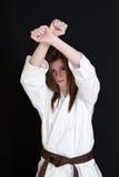 Karate girl. A karate girl on black background stock photos