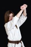 Karate girl. A karate girl on black background stock photo