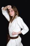 Karate girl. A karate girl on black background royalty free stock photos