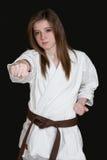 Karate girl. A karate girl on black background royalty free stock image