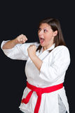 Karate girl. A karate girl on black background stock photography
