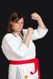 Karate girl. A karate girl on black background stock image