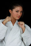 Karate Girl. Beautiful young teen in karate suit Stock Photo