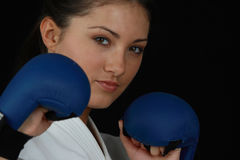 Karate Girl. Beautiful young teen in karate suit Royalty Free Stock Image