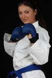 Karate Girl. Beautiful young teen in karate suit Stock Photography