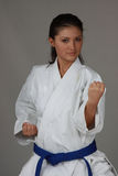 Karate Girl. Beautiful young teen in karate suit Royalty Free Stock Images