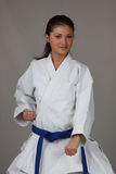 Karate Girl. Beautiful young teen in karate suit Stock Images