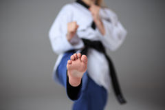 The karate girl with black belt Royalty Free Stock Photos