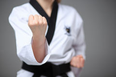 The karate girl with black belt Stock Images