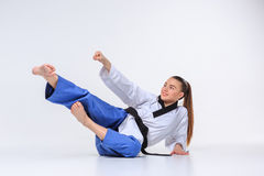 The karate girl with black belt Royalty Free Stock Images