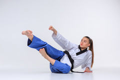 The karate girl with black belt Stock Photography