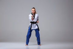 The karate girl with black belt Stock Image