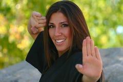 Karate Girl Blocking Royalty Free Stock Photography