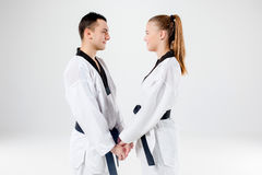 The karate girl and boy with black belts Stock Photos