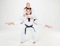 The karate girl and boy with black belts Stock Photography