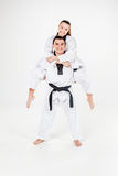 The karate girl and boy with black belts Stock Image