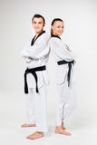 The karate girl and boy with black belts Royalty Free Stock Photo