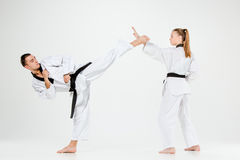The karate girl and boy with black belts Royalty Free Stock Photography
