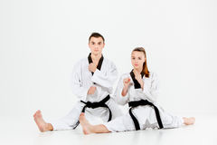 The karate girl and boy with black belts Stock Images