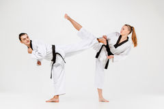 The karate girl and boy with black belts Royalty Free Stock Image