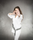 Karate girl defending Stock Image