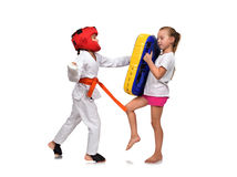 Karate girl  It fulfills blows hand Stock Images