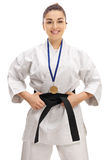 Karate girl with a gold medal smiling Royalty Free Stock Photos