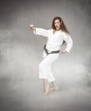 Karate girl hitting Royalty Free Stock Images