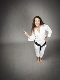 Karate girl indicated. Expression and emotions for people royalty free stock photos