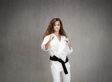 Karate girl ready to fight. Expression and emotions for people Royalty Free Stock Image