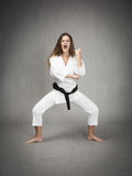 Karate girl ready to fight. Expression and emotions for people Stock Images