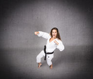 Karate girl ready to hit Royalty Free Stock Photos