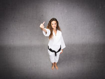 Karate girl rude gesture Royalty Free Stock Photo