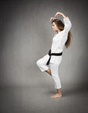 Karate girl rude profile hit Stock Photos