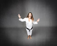 Karate girl screaming Stock Images