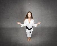 Karate girl zen style Royalty Free Stock Image