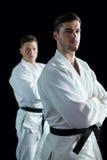 Karate gracze stoi z rękami krzyżować obraz stock