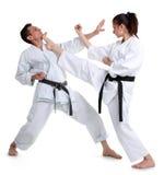 Karate. Jong meisje en mensen in een kimono. Stock Foto's