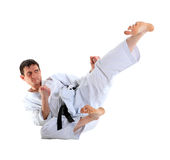 Karate jump against Stock Photos